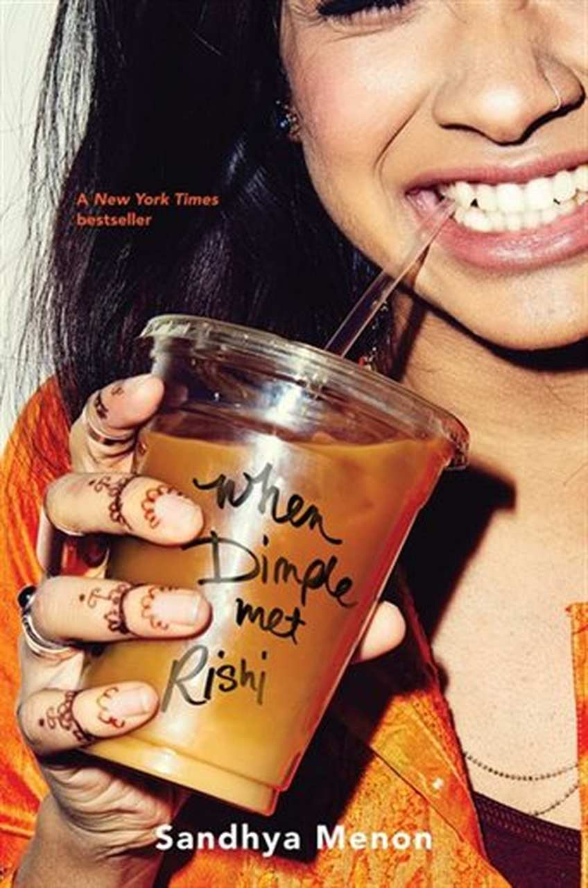 Indian Girl in Orange Sari drinking iced coffee