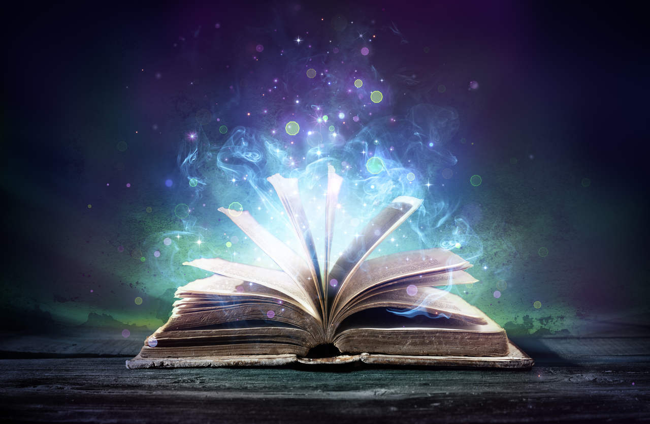 Open book with blue, purple light shining out of pages